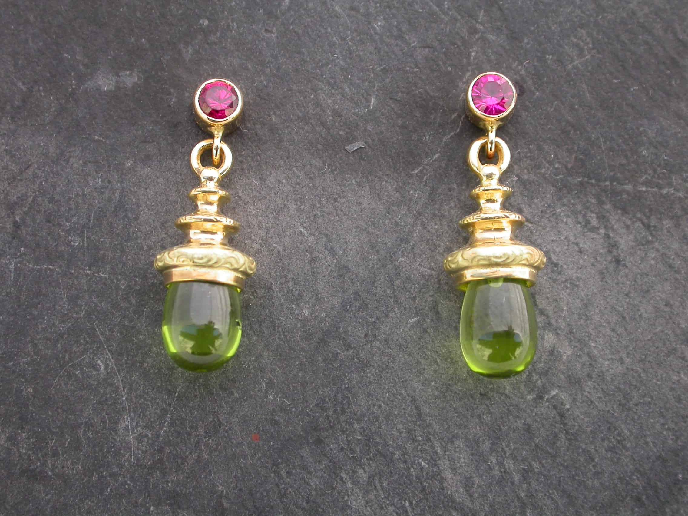 Unique earrings, peridot, rubies, 18ct gold